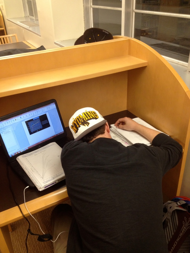Richard Gilmore, junior, is fatigued from studying so decides to take a quick power nap in Coe Library.